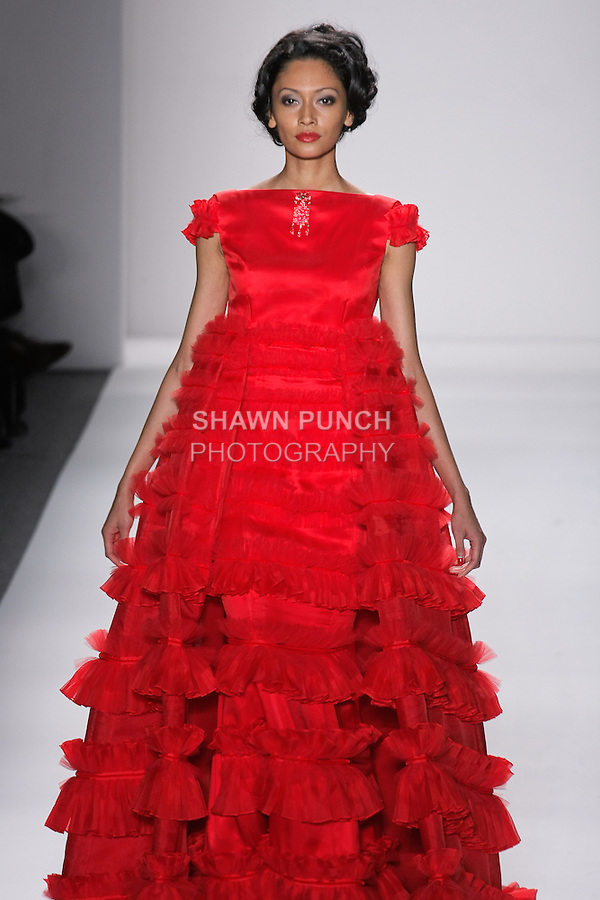 """Model walks runway in a ruby silk organza princess ballgown w/pleated organza+tulle+ribbon fuffled borders, from the Zang Toi Fall 2012 """"Glamour At Gstaad"""" collection, during Mercedes-Benz Fashion Week New York Fall 2012 at Lincoln Center."""