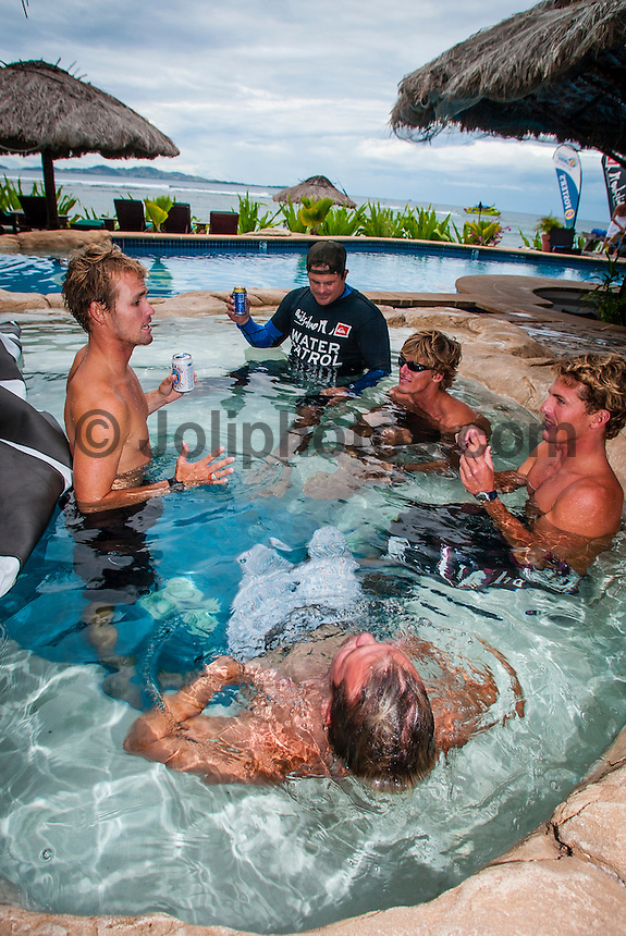 Cloudbreak, Fiji. Damien Hobgood (USA) took out the 2004 Quiksilver Pro Fiji defeating Andy Irons (HAW) in the final. Shown here with Bruce Irons (HAW), CJ Hobgood (USA) and Kai Borg (HAW) in the pool at Tavarua Island resort. Photo: joliphotos.com