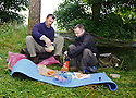 *** WARNING CONTENT MAY NOT BE SUITABLE FOR ALL ***.Sun man Gordon Tait joins naked rambler Stephen Gough for a delivered takeaway dinner from a local Indian takeaway in the woods near Kinross.