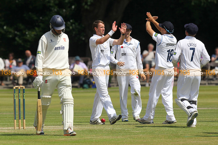 Tony Palladino of Derbyshire (2nd L) is congratulated on the wicket of Tom Moore - Derbyshire CCC vs Essex CCC - LV County Championship Division Two Cricket at Queen's Park, Chesterfield - 09/07/14 - MANDATORY CREDIT: Gavin Ellis/TGSPHOTO - Self billing applies where appropriate - 0845 094 6026 - contact@tgsphoto.co.uk - NO UNPAID USE