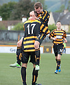 Alloa's Eddie Ferns (17) is congratulated by Alloa's Graeme Holmes after he scores their third goal.