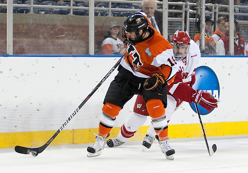 08 April 2010: RIT Forward Tyler Mazzei (#19) battles Wisconsin defender in game action between the Wisconsin Badgers and the Rochester Institute of Technology (RIT) Tiger at Ford Field in Detroit, Michigan.  Wisconsin defeated RIT 8-1. Mandatory Credit: John Mersits / Southcreek Global