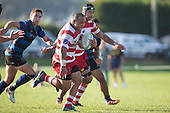 Sione Anga'aelangi charges upfield with Onewhero defenders giving chase. Counties Manukau Premier Club Rugby game between Karaka and Onehwero played at Karaka Sports Park on Saturday May 7th 2016. Karaka won the game 46 - 9 after leading 20 - 9 at half time. Photo by Richard Spranger.
