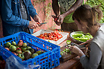 Volunteers and migrants prepare vegetables for lunch in Lakaxita. Irun (Basque Country). August 14, 2018. Lakaxita is a self-managed socio-cultural space located in an occupied house, where voluntiers have created a hosting network for migrants in transit who have already completed the 5-day period that can remain in public resources. This group of volunteers is avoiding a serious humanitarian problem Irún, the Basque municipality on the border with Hendaye. As the number of migrants arriving on the coasts of southern Spain incresead, more and more migrants are heading north to the border city of Irun. (Gari Garaialde / Bostok Photo)