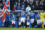 Rangers captain Steven Davis leads out the teams for the first home game after administration for Rangers