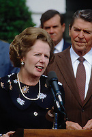 Washington, DC., USA, September 29, 1983<br /> British Prime Minister Margaret Thatcher and President Ronald Reagan deliver remarks at The South Portico of the White House after their meetings in the Oval Office. Credit: Mark Reinstein/MediaPunch