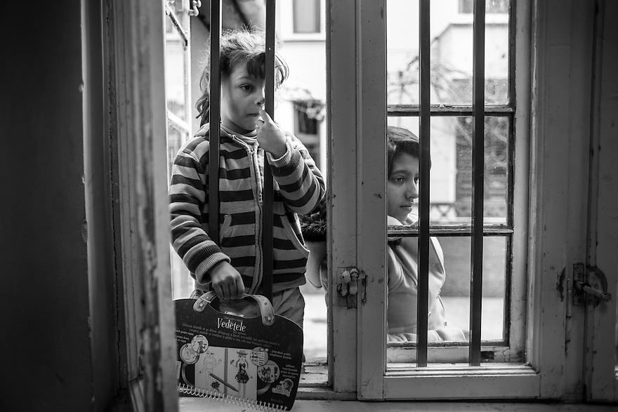 Pepita, 4, a homeless child being cared for by her young aunt, passes time at the Parada Center in Bucharest, which provides meals, showers and other facilities to homeless youth. Thousands of minors and young adults live in Bucharest's vast system of underground canals used for heating, water and sewage pipes. Many were raised in Romania's vast orphanage system. Addiction, especially to huffing metallic paint, heroine and other injected drugs is widespread.