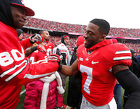 Ohio State Buckeyes player Jordan Hall embraces family as nineteen seniors were recognized before Saturday's NCAA Division I football game against Indiana at Ohio Stadium in Columbus on November 23, 2013. (Barbara J. Perenic/The Columbus Dispatch)