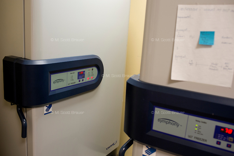 Freezers holding fecal samples and microbiota preparations stand in a corner of a lab in MIT's Microbiology Program in Cambridge, Massachusetts, USA. The freezers keep the donated fecal materials at about -80 degrees F. The OpenBiome project screens donations for a variety of disease agents and then provides these samples to hospitals around the US for treatment of clostridium difficile infection, which affects approximately 500,000 people in the US and kills about 14,000 annually. The samples are used in fecal microbiotal transplants (fecal transplants) and work as extremely efficient treatment for c. difficile infections.