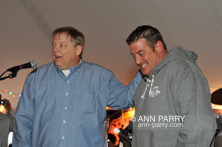 Fund raiser for firefighter Ray Pfeifer on Saturday, March 31, 2012, at East Meadow Firefighters Benevolent Hall, New York, USA. Ray Pfeifer (left) and his brother (right) spoke on stage.