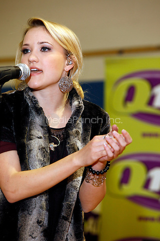 Emily Osment at The Whiting School, who won a contest f rom Q102 to have Emily Osment perform in Whiting, NJ on February 4, 2011  © Star Shooter / MediaPunchInc