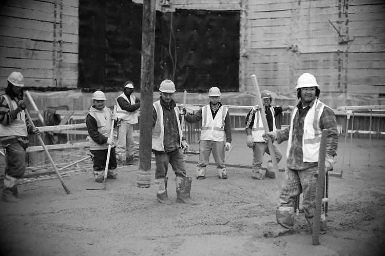 ©2012 David Burnett/.Contact Press Images.Washington DC.November 19 2012..construction workers at the Louis / 14th st construction project (14th & U st Washington DC)   by JBG.