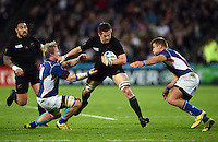 Richie McCaw of New Zealand takes on the Namibia defence. Rugby World Cup Pool C match between New Zealand and Namibia on September 24, 2015 at The Stadium, Queen Elizabeth Olympic Park in London, England. Photo by: Patrick Khachfe / Onside Images