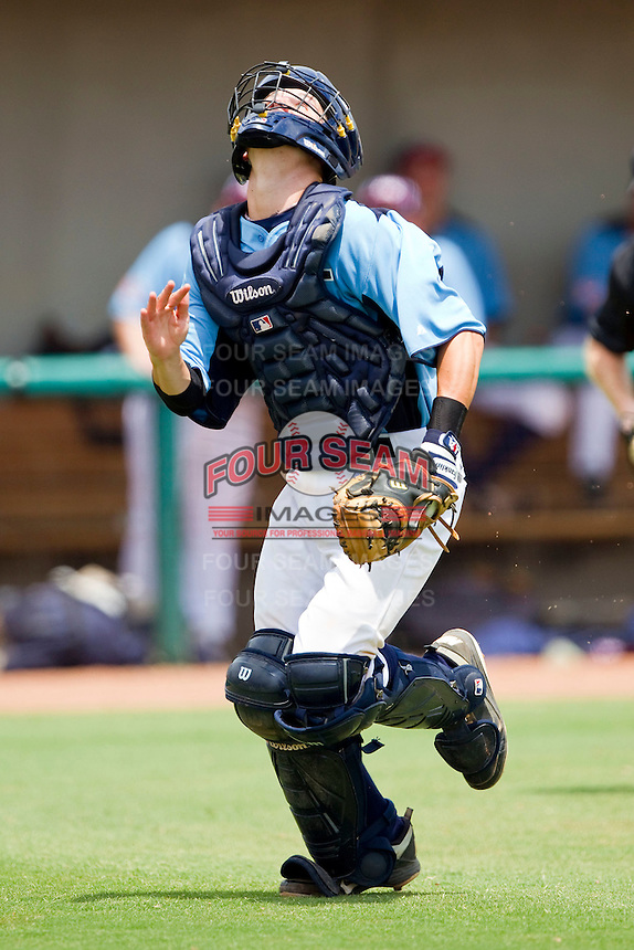Catcher Chris Okey #11 of Dixie chases after a foul pop fly during the game against AABC at the 2011 Tournament of Stars at the USA Baseball National Training Center on June 25, 2011 in Cary, North Carolina.  The AABC defeated Dixie 4-2.  (Brian Westerholt/Four Seam Images)