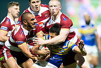 Picture by Allan McKenzie/SWpix.com - 13/04/2018 - Rugby League - Betfred Super League - Leeds Rhinos v Wigan Warriors - Headingley Carnegie Stadium, Leeds, England - Ashton Golding is tackeld by Thomas Leuluai and Liam Farrell.