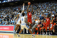 CHAPEL HILL, NC - JANUARY 11: Aamir Simms #25 of Clemson University shoots the game tying three pointer with four seconds left in regulation over Garrison Brooks #15 of the University of North Carolina during a game between Clemson and North Carolina at Dean E. Smith Center on January 11, 2020 in Chapel Hill, North Carolina.