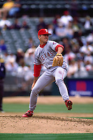 OAKLAND, CA - John Burkett of the Texas Rangers pitches during a game against the Oakland Athletics at the Oakland Coliseum in Oakland, California in 1998. (Photo by Brad Mangin)