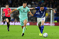 Lee Tomlin of Cardiff City is fouled by Olamide Shodipo of Queens Park Rangers during the Sky Bet Championship match between Cardiff City and Queens Park Rangers at the Cardiff City Stadium in Cardiff, Wales, UK. Wednesday 02 October, 2019