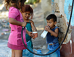 Roma children get water from a hose in the Maxsuda neighborhood of Varna, Bulgaria, where many Turkish-speaking Roma live.