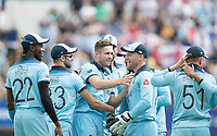 Chris Woakes (England) and team mates celebrate the wicket of David Warner during Australia vs England, ICC World Cup Semi-Final Cricket at Edgbaston Stadium on 11th July 2019