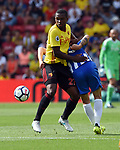 Christian Kabasele of Watford is challenged Pascal Grob of Brighton & Hove Albion by during the premier league match at the Vicarage Road Stadium, Watford. Picture date 26th August 2017. Picture credit should read: Robin Parker/Sportimage