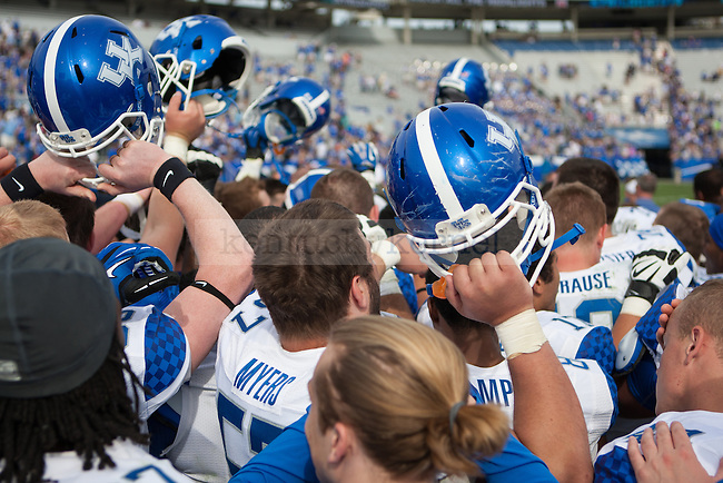 The football team breaks down their huddle after the Blue/White Spring Game in Lexington, Ky., on Saturday, April 26, 2014. Blue defeated White 38-14. Photo by Adam Pennavaria | Staff