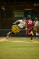 Savannah Bananas first baseman Daniel Oberst (28) attempts to catch an errant throw as Robert Brooks (37) runs up the base line during a Coastal Plain League game against the Macon Bacon on July 15, 2020 at Grayson Stadium in Savannah, Georgia.  Savannah wore kilts for their St. Patrick's Day in July promotion.  (Mike Janes/Four Seam Images)