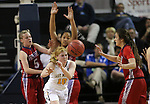 Manogue's Tawni Henderson passes under pressure from Liberty Patriots, from left, London Pavlica, Lisa Tauala and Celine Quintino during the NIAA Division I state basketball tournament in Reno, Nev. on Thursday, Feb. 25, 2016. Liberty won 59-53. Cathleen Allison/Las Vegas Review-Journal