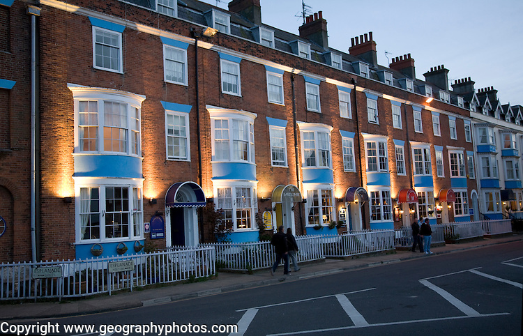 Row of guest houses and small hotels at night on the Esplanade, Weymouth, Dorset, England