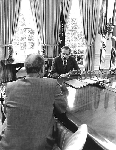 White House photo from 8 August, 1974 of a meeting between United States President Richard M. Nixon and U.S. Vice President Gerald R. Ford discussing the former's resignation from the U.S. Presidency..Credit: The White House / CNP