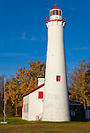 Alcona County, Michigan<br /> Sturgeon Point Light (1869) in morning light with blue sky