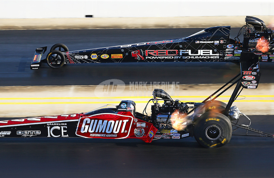 Sep 19, 2015; Concord, NC, USA; NHRA top fuel driver Leah Pritchett (near) races alongside Shawn Langdon during qualifying for the Carolina Nationals at zMax Dragway. Mandatory Credit: Mark J. Rebilas-USA TODAY Sports