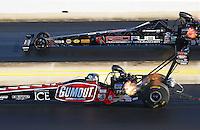 Sep 19, 2015; Concord, NC, USA; NHRA top fuel driver Leah Pritchett (near) races alongside Shawn Langdon during qualifying for the Carolina Nationals at zMax Dragway. Mandatory Credit: Mark J. Rebilas-USA TODAY Sports