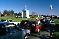Vehicle Traffic lining up to cross Peace Arch International Border Crossing / Douglas Border Crossing, from Surrey (near White Rock), BC, British Columbia, Canada to Blaine, WA, Washington, USA - Peace Arch Monument (built 1921) in Peace Arch International Park