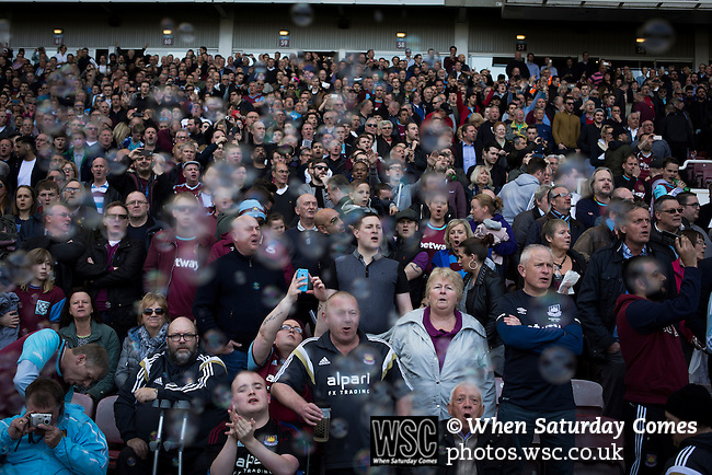 West Ham United 2 Crystal Palace 2, 02/04/2016. Boleyn Ground, Premier League. Home fans pictured with bubbles floating in front of the Betway Stand prior to the kick-off at the Boleyn Ground before West Ham United hosted Crystal Palace in a Barclays Premier League match. The Boleyn Ground at Upton Park was the club's home ground from 1904 until the end of the 2015-16 season when they moved into the Olympic Stadium, built for the 2012 London games, at nearby Stratford. The match ended in a 2-2 draw, watched by a near-capacity crowd of 34,857. Photo by Colin McPherson.