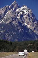Teton Mountain Range from park road with cars. Grand Teton National Park, Wyoming.