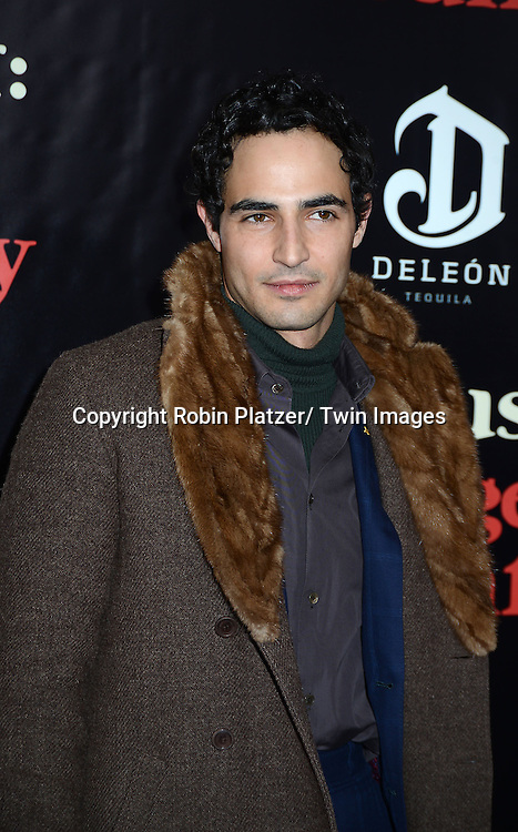 """Zac Posen attends the New York Premiere of """"August: Osage County"""" on December 12, 2013 at the Ziegfeld Theatre in New York City."""
