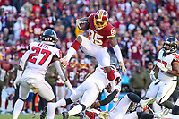 Landover, MD - November 4, 2018: Washington Redskins tight end Vernon Davis (85) leaps over Atlanta Falcons defensive back Sharrod Neasman (41) during the  game between Atlanta Falcons and Washington Redskins at FedEx Field in Landover, MD.   (Photo by Elliott Brown/Media Images International)