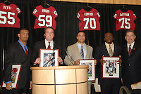 14 January 2007: Bob Bowlsby presents awards to Brandon Harrison, T.C. Ostrander, Trevor Hooper, and Wopamo Osaisai at the annual football banquet at McCaw Hall in Stanford, CA.
