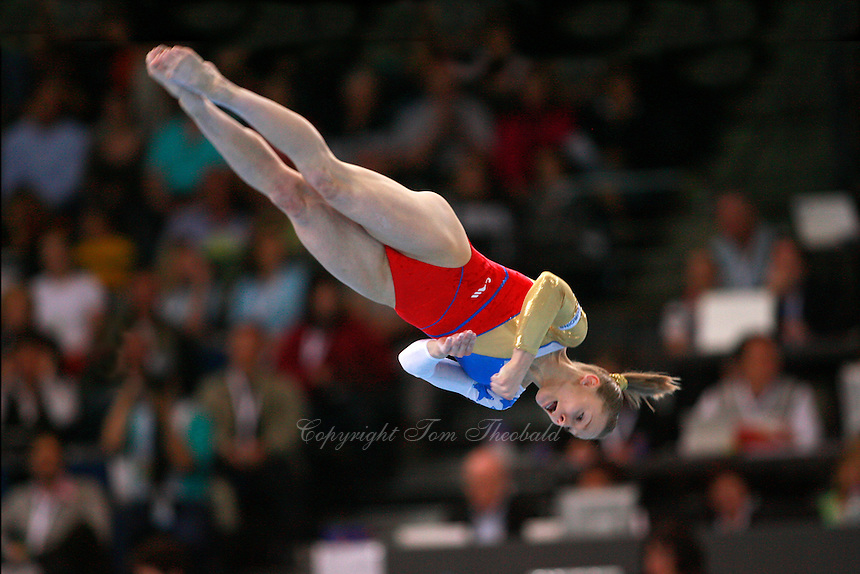 September 5, 2007; Stuttgart, Germany;  Sandra Izbasa of Romania performs twist on floor exercise tumbling pass  during team finals in women's artistic gymnastics at 2007 World Championships. Photo by Copyright 2007 Tom Theobald