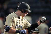 Gavin Sheets (24) of the Wake Forest Demon Deacons returns to the dugout after hitting a sacrifice fly against the UNCG Spartans at David F. Couch Ballpark on February 21, 2017 in  Winston-Salem, North Carolina.  The Demon Deacons defeated the Spartans 15-8.  (Brian Westerholt/Four Seam Images)