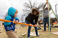 NWA Democrat-Gazette/CHARLIE KAIJO Wit Galloway, 3, of Gravett (from left) helps his mom and dad Rachel and Ian Galloway build a teepee from found materials, Monday, March 19, 2018 at the Amazeum in Bentonville. <br /><br />The adventure playground or &quot;junk playground&quot; allows kids to create their own play space from found materials. The idea is based on a theory of play in existence in Europe since after World War II. People noticed children were playing more in spaces that were bombed out and had loose parts they could interact with rather than the adult designed playgrounds said Jess Graff of Portland, Ore. who brought the idea to Amazeum.<br /><br />&quot;Kids can build a lot of different skills, independence, confidence, teamwork,&quot; Graff said. &quot;As adults we can remember a time as a child we were having a fantastic time. Often those are experiences where there&acirc;&euro;&trade;s a little bit of risk involved in the play.&quot;