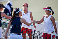 STANFORD, CA - January 26, 2011: Hilary Barte and Stacey Tan of Stanford women's tennis shake hands after their match against UC Davis' Chui/Heneghan. Barte/Tan won 8-2.