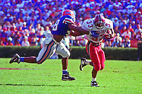 Brandon Bennett (33), Dexter Daniels (48), University of Florida Gators defeat the University of South Carolina Gamecocks 48-17 at Ben Hill Griffin Stadium, Florida Field, Gainseville, Florida, November 12, 1994 . (Photo by Brian Cleary/www.bcpix.com)
