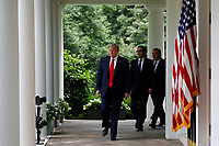 United States President Donald J. Trump, left, arrives to deliver remarks on China in the Rose Garden at the White House in Washington, DC on May 29, 2020.  Walking behind the president are US Secretary of the Treasury Steven T. Mnuchin, center, and US Secretary of State Mike Pompeo, right.<br /> Credit: Yuri Gripas / Pool via CNP/AdMedia