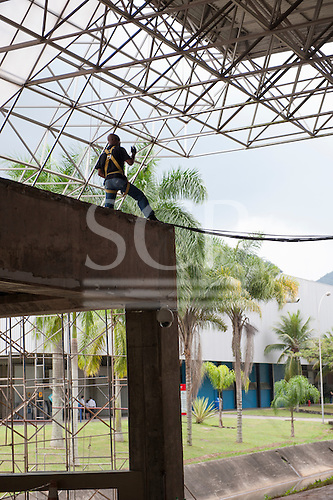 A worker using safety equipment rigs wiring in the build-up for the conference at the Rio Centre venue. United Nations Conference on Sustainable Development (Rio+20), Rio de Janeiro, Brazil. Photo © Sue Cunningham.
