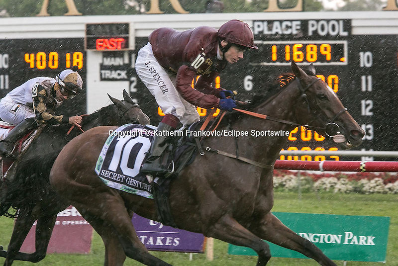 August 15, 2015. Secret Gesture and jockey Jamie Spencer crossing the finish of the G1 Secretariat Stakes. They were later disqualified and placed 3rd. Katherin Frankovic/ESW/CSM