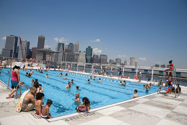 """The Floating Lady,"" a floating swimming pool moored in the East River at the Brooklyn Bridge Park Beach."