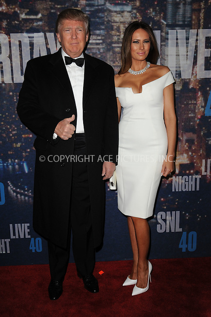 WWW.ACEPIXS.COM<br /> February 15, 2015 New York City<br /> <br /> Donald Trump and Melania Trump walking the red carpet at the SNL 40th Anniversary Special at 30 Rockefeller Plaza on February 15, 2015 in New York City.<br /> <br /> Please byline: Kristin Callahan/AcePictures<br /> <br /> ACEPIXS.COM<br /> <br /> Tel: (646) 769 0430<br /> e-mail: info@acepixs.com<br /> web: http://www.acepixs.com