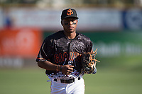 San Jose Giants second baseman Jalen Miller (2) jogs off the field between innings of a California League game against the Lancaster JetHawks at San Jose Municipal Stadium on May 12, 2018 in San Jose, California. Lancaster defeated San Jose 7-6. (Zachary Lucy/Four Seam Images)